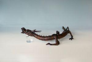 Dragon in articulated bush