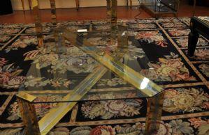 Tavolino da salotto in vetro ottone e acciaio
