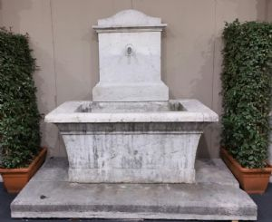 Ancient fountain in Botticino marble