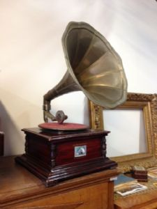 Gramophone with brass trumpet, functional (missing pin) album with some 78s