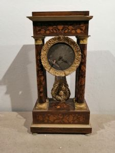Early 19th century pendulum in bronze and inlaid wood