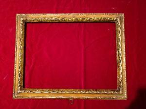 bella cornice in legno laccato beige e argentata nella parte intagliata luce cm.56 x 41