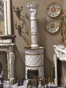 stufa cilindrica con il suo tubo  alsaziana con trofeo nella parte superiore