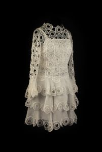 White dress with embroidered decoration optical 60s