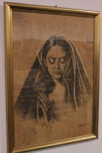 Numbered and signed print with glass and frame depicting a woman with veil / maria