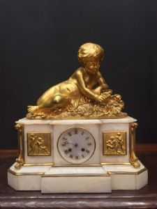 MAGNIFICENT CLOCK WITH PUTTO AND CANDELABRI