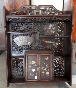 cabinet with shelves and figures