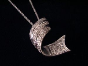 Colgante con diamante 1 ct.