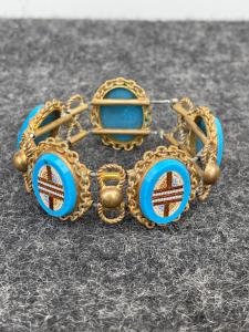Brass bracelet (with elastic) and five micromosaic ovals with geometric motifs. Rome