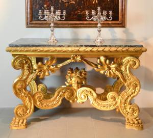 Importante consolle in legno intagliato, scolpito e dorato, Roma fine Seicento