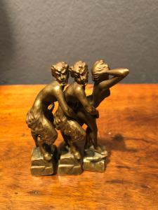 Group of three interlocking bronzes with an erotic subject with a female figure and two satyrs. Austria.