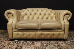 Two seater Chesterfield club sofa in light brown leather