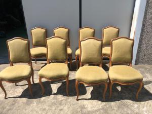 Eight Louis Philippe period cherry chairs.