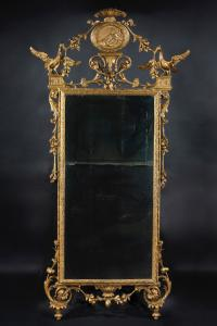 Large Tuscan mirror in carved and gilded wood