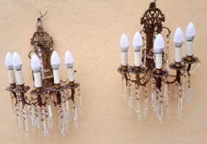 coppia di appliques in bronzo dorato a cinque luci