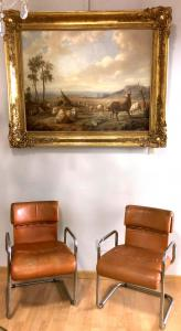Pair of vintage leather and steel armchairs