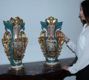 Pair of antique polychrome porcelain vases finished in gold with popular scenes painted in the manner of Raffaele Giovine.