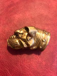 Brass matchbox in the shape of a dog's head.