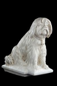Escultura que representa perro