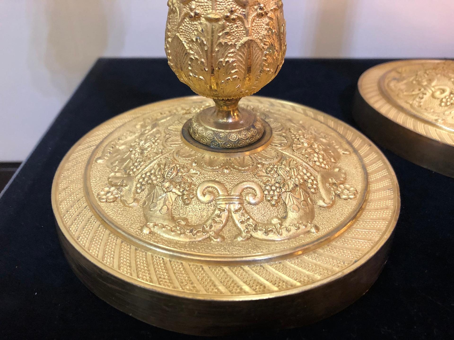 thumb7|Coppia di bugie in bronzo dorato Impero Francia 1810
