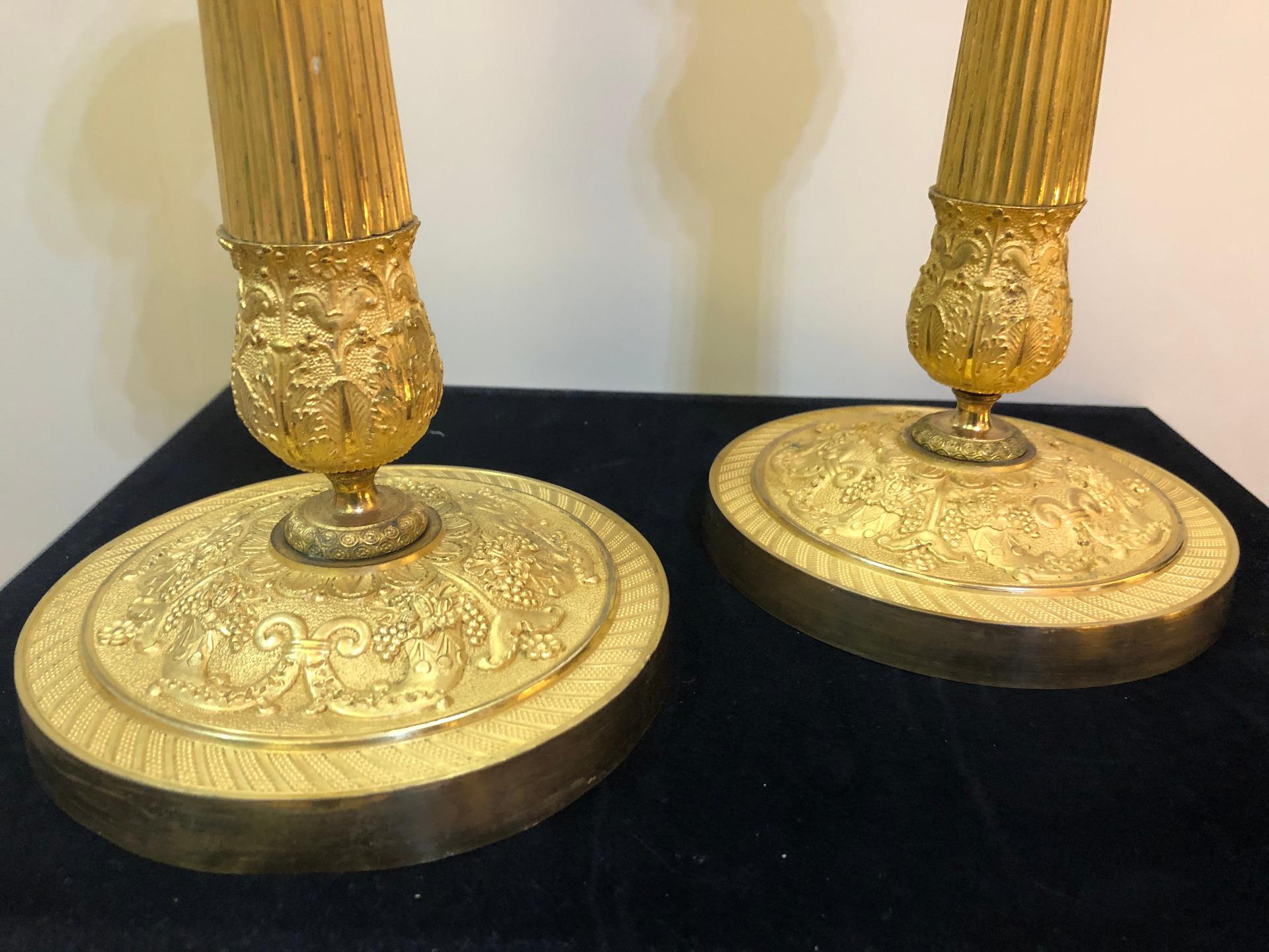 thumb2|Coppia di bugie in bronzo dorato Impero Francia 1810