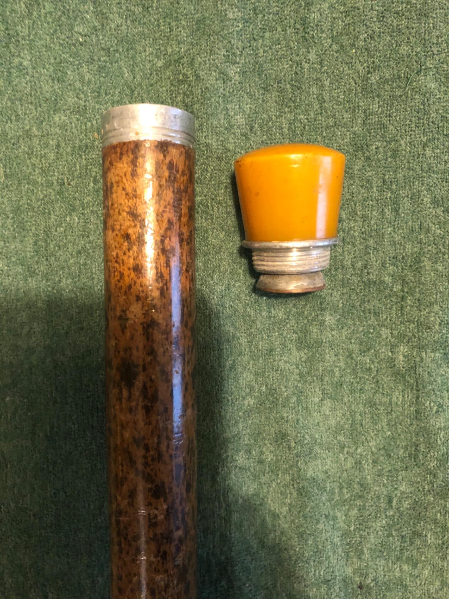 thumb4|Bastone 'pila' con pomolo in Bakelite che si illumina (tramite pila da inserire all'interno).