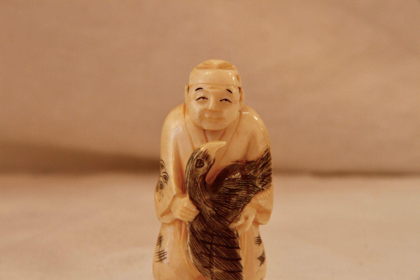thumb6|Okimono cinese in avorio, XIX secolo