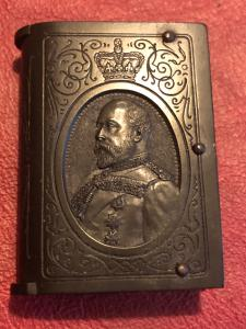 Book-shaped bakelite matchbox with a profile of King Edward VII and inscription of the order of the garter.England.
