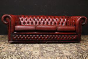 Three seater Chesterfield sofa with bamboo-style leather decorations