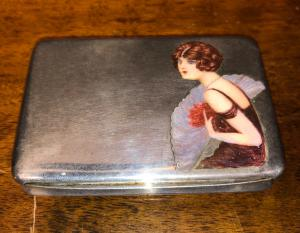 Silver and enamel cigarette case with lady figure with fan.Italy.