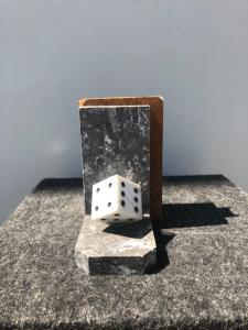 Pair of marble bookends depicting game dice.