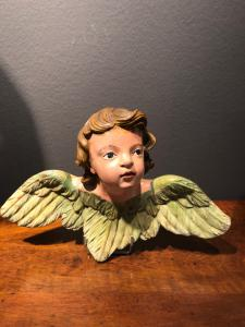 Wooden sculpture, head of cherub. Liguria.
