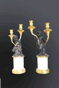 Pair of two-light candlesticks in gilded and patinated chiseled bronze with base in white Carrara marble.