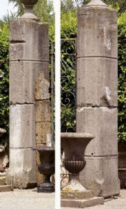 Pair of ancient stone gate columns. Early 1900s.