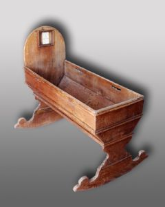 Ancient wooden cradle. Period 1800.