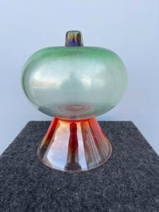 Globular vase in iridescent glass on a truncated cone base.Escribed logo BS.Murano