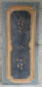 Door to a door painted with floral motifs