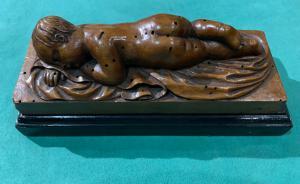 Escultura de buxo