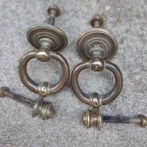Pair of complete bronze door knockers