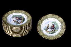 Servizio formato da 12 piatti da dolce in porcellana decorata inglese del 1800