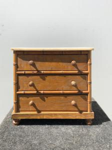 Model of sweet wood chest of drawers with bamboo details and marble top.