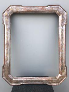 Cabaret frame in carved and silvered wood with golden stylized vegetal details.