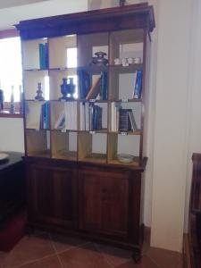 Particular wooden bookcase with various compartments, in walnut and doors, central Italy 19th century