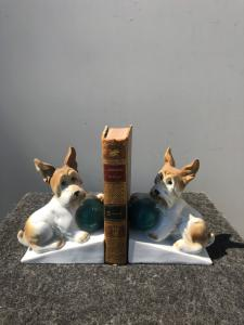 Pair of porcelain bookends depicting dogs.