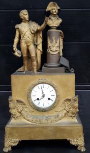 Reloj de bronce dorado