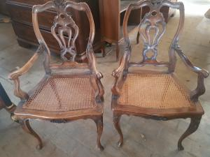 Pair of 18th century style chairs with armrests