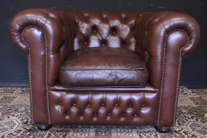 Original Chesterfield club armchair in brown trunk leather