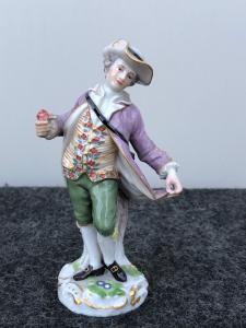Estatueta de porcelana, representando o personagem masculino com sorvete.Meissen.Germany.