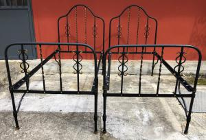 pair of wrought iron beds
