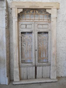 Liberty-style portal in yellow sandstone with wooden door